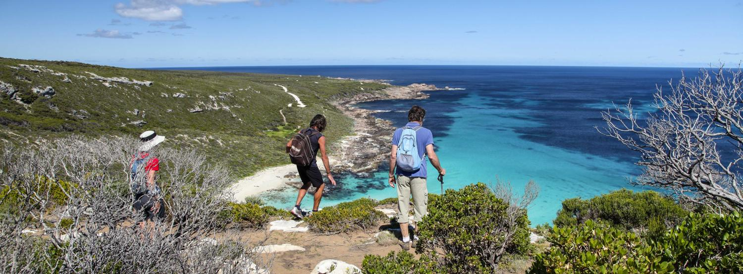Hikers above beautiful Contos Beach